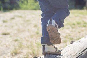 Boy walking on log
